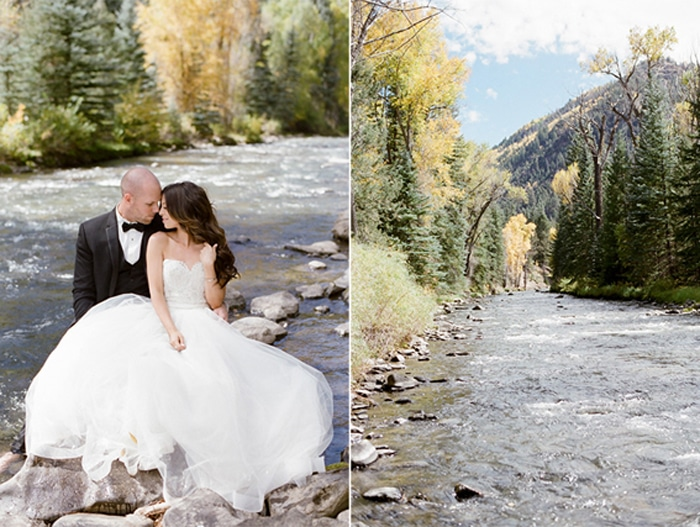 Wedding couple posing along the river in Colorado
