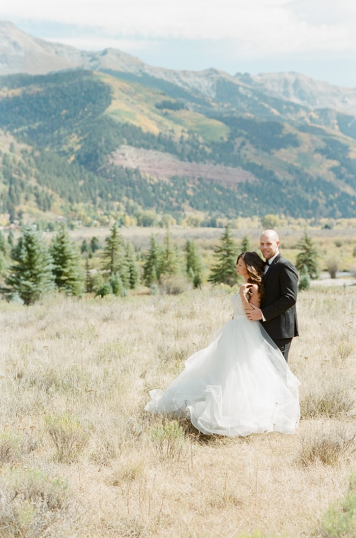 Groom embracing bride during Telluride elopement portraits
