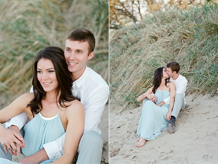 Engagement session of couple sitting on the sand