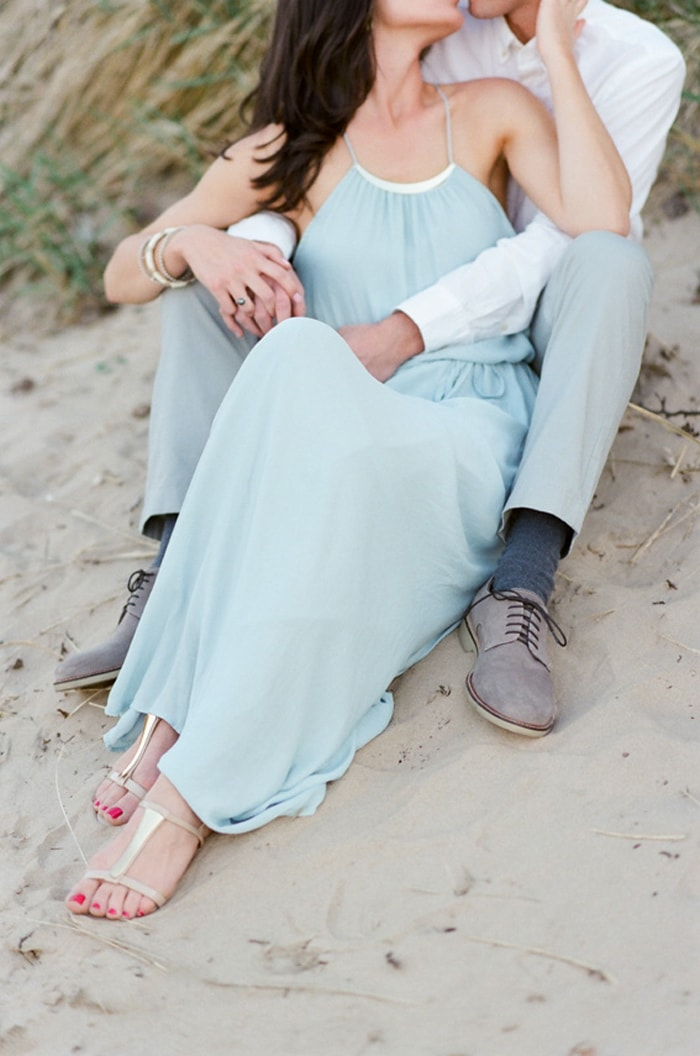 Woman in blue dress with groom-to-be relaxing
