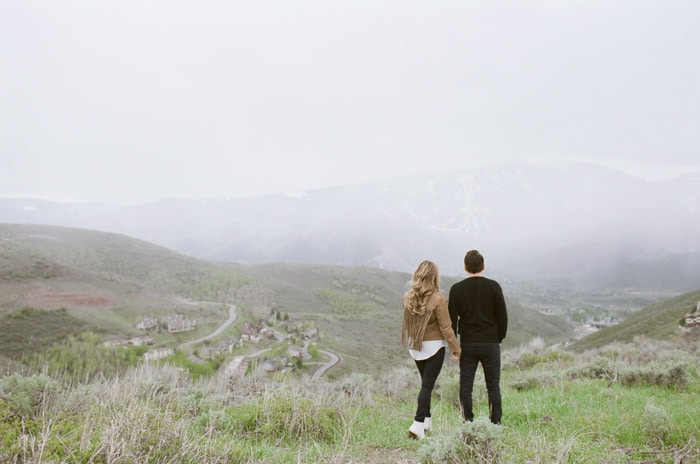 Couple looking out into the distance with wide view of Vail mountaintop