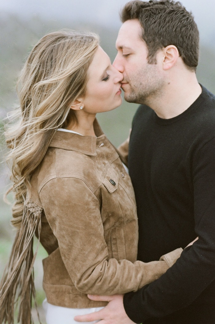 Engaged couple kissing during engagement session