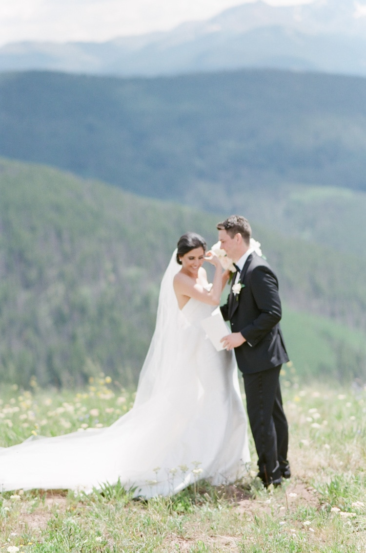 Bride and groom seeing each other for the first time on their wedding day with mountains in the background