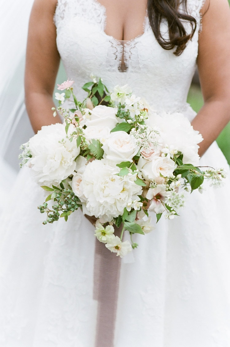 Classic white wedding bouquet with trailing ribbon