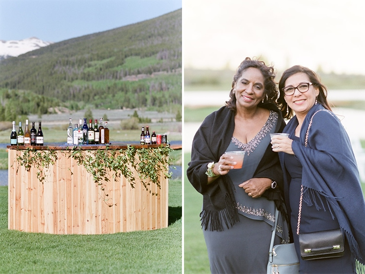 Rustic bar and wedding guests at Camp Hale