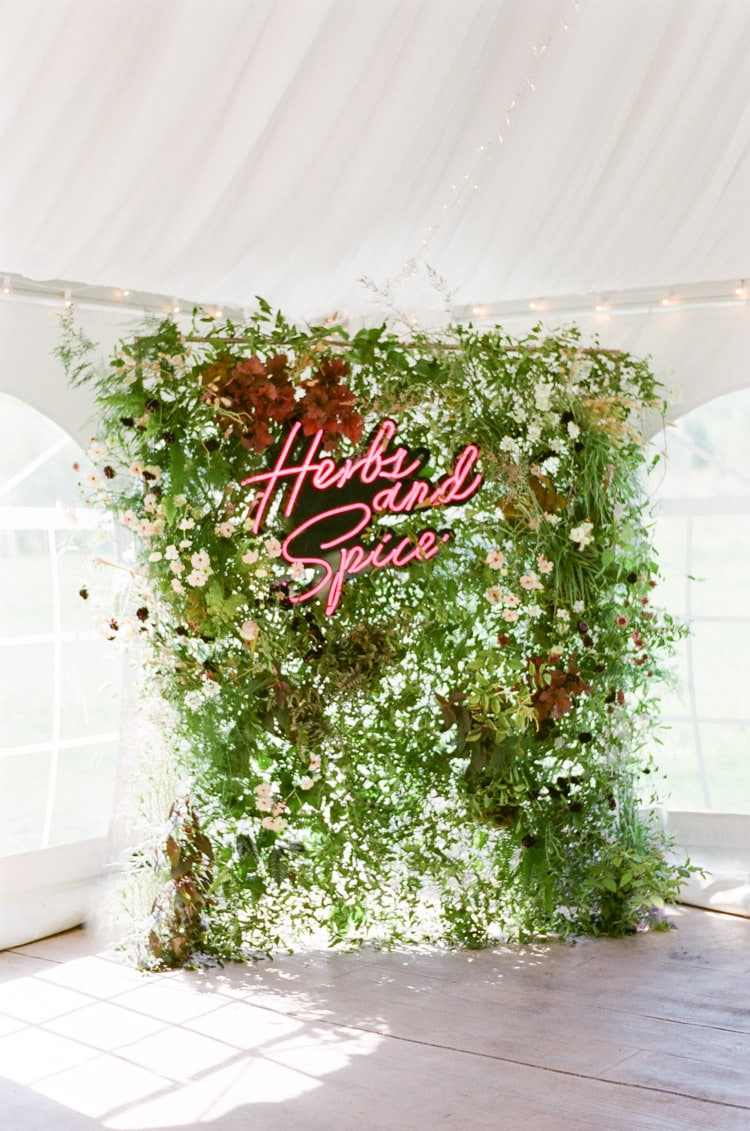 Floral photo backdrop with custom neon signage
