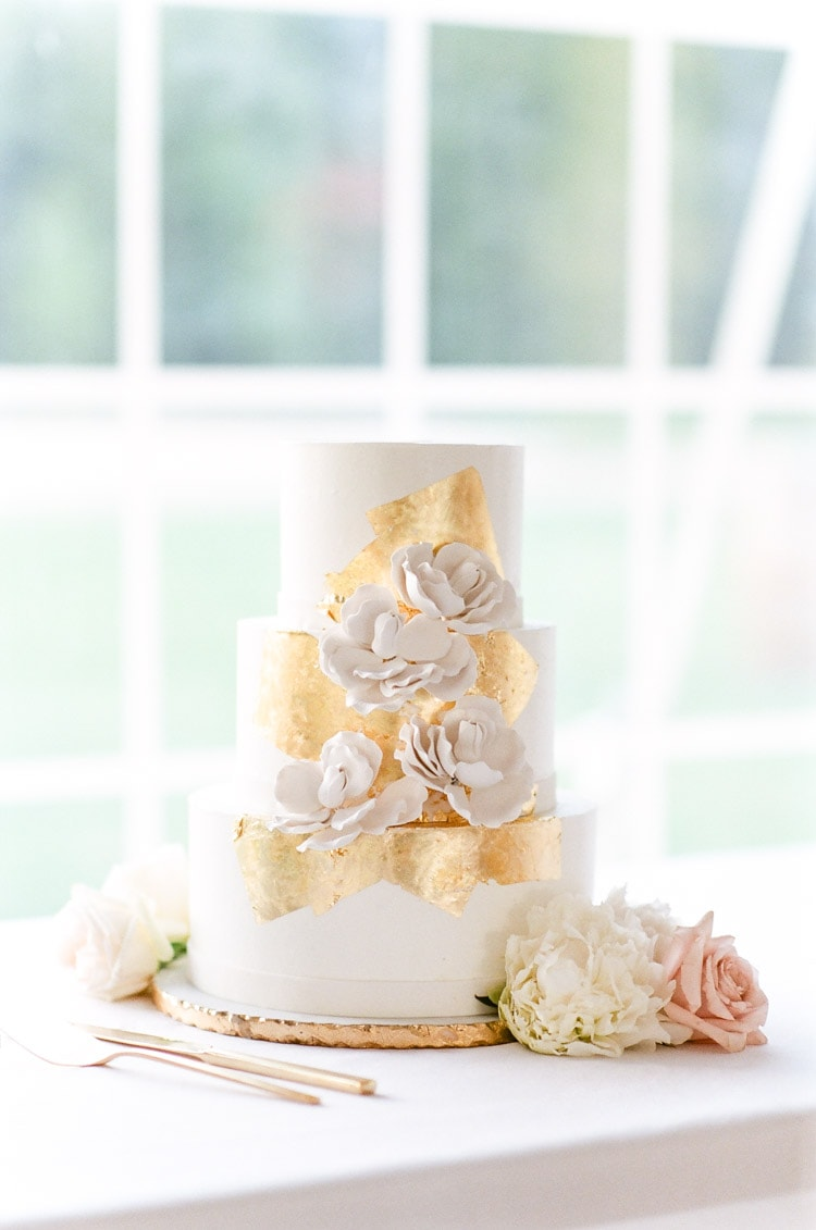 White wedding cake with floral details
