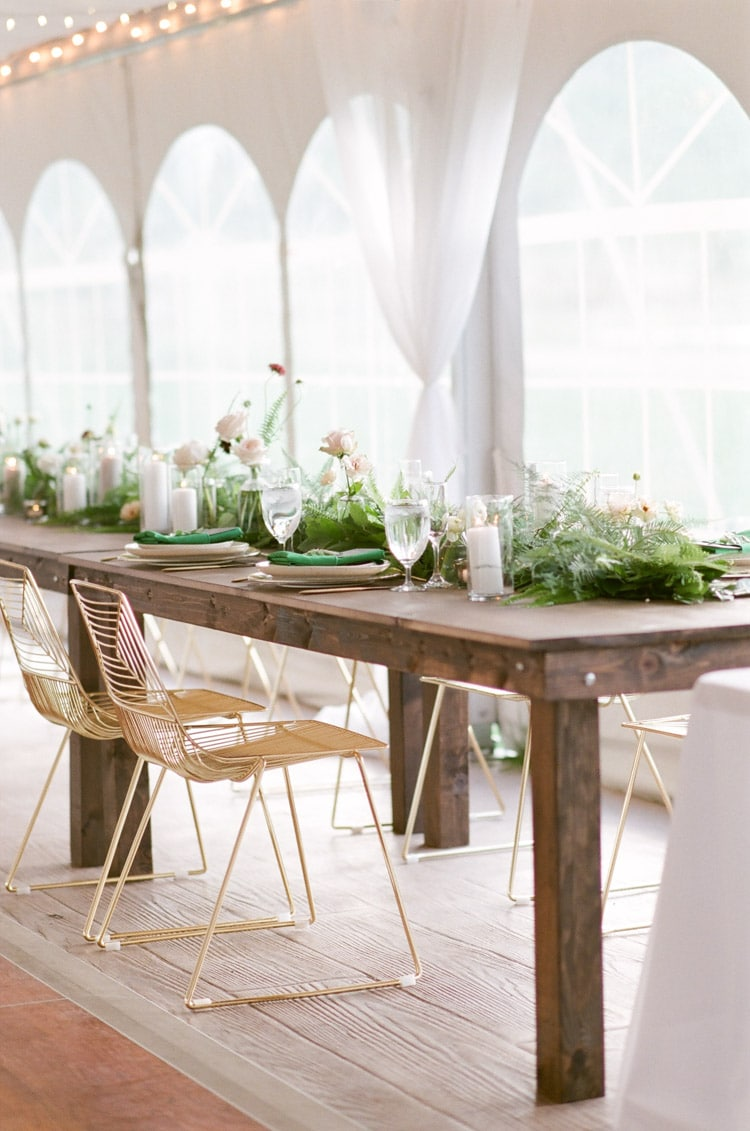 Rustic table and floral table runner with modern chairs