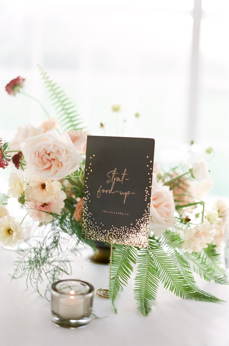 Black table number and floral centerpiece
