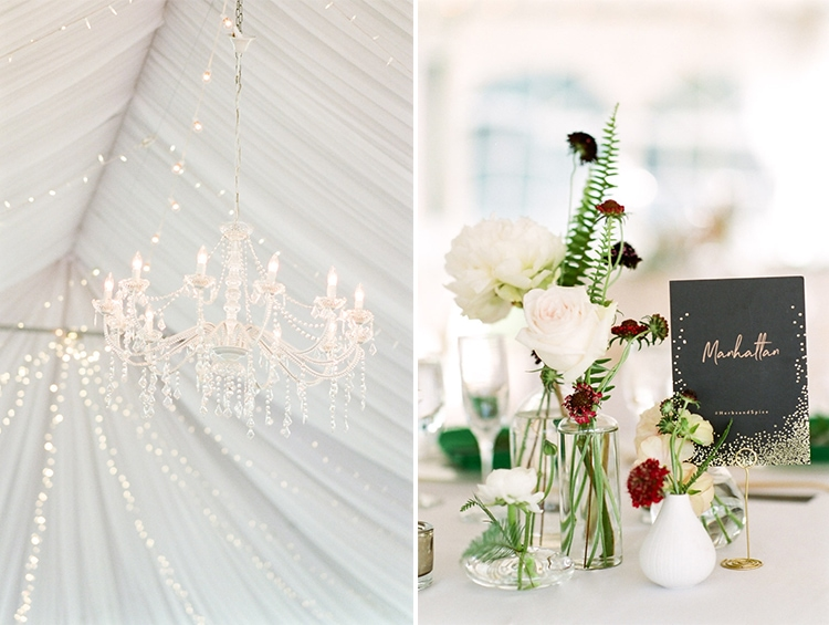 Chandelier and simple flower arrangements at tented wedding reception