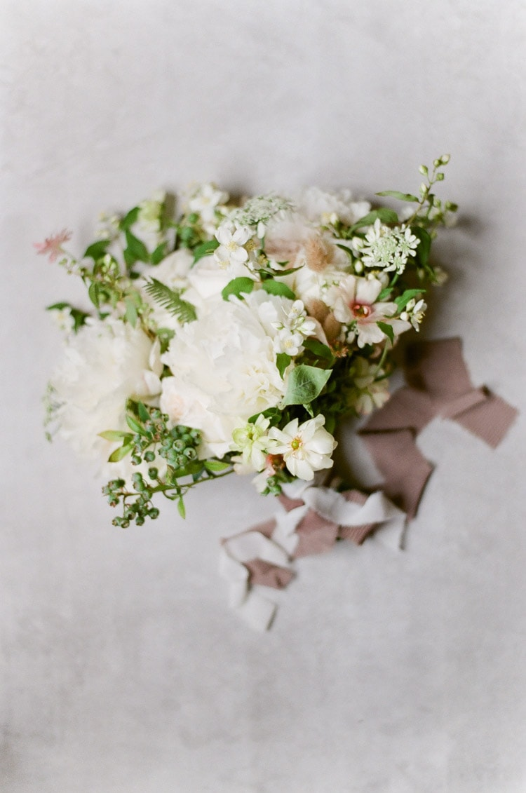 Flat lay of a white wedding bouquet