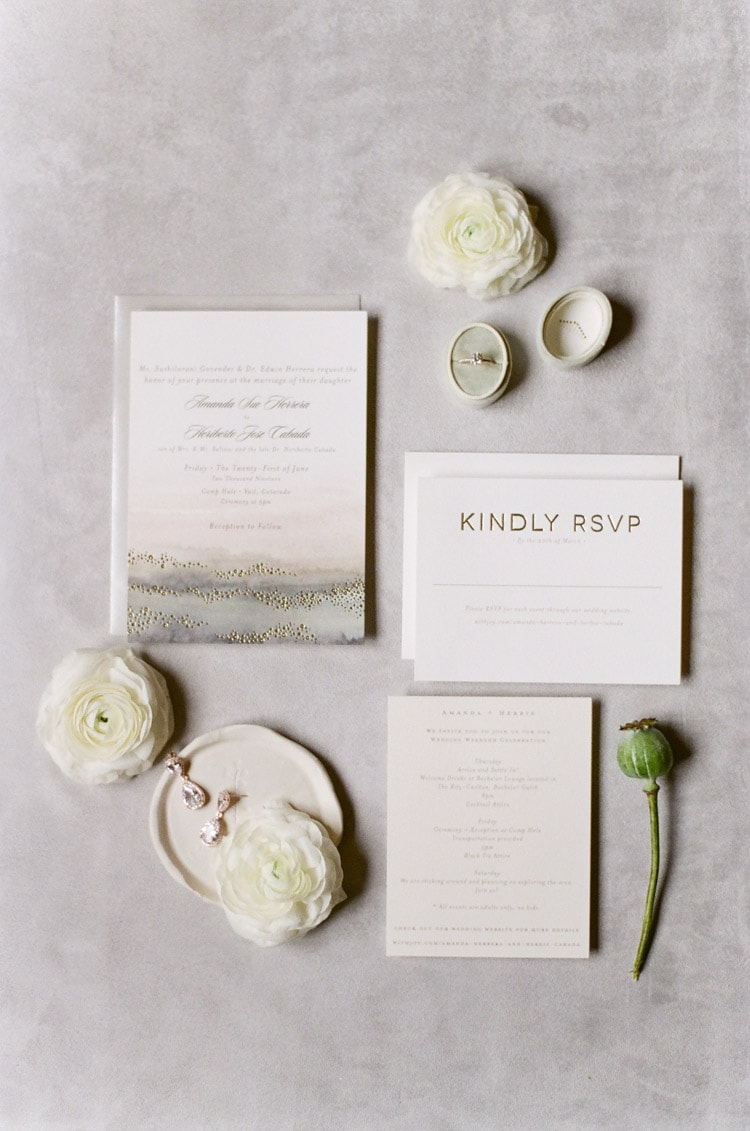 Flat lay of minimalist invitation suite for a Colorado wedding