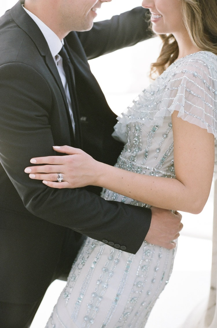 Couple embracing during engagement portraits in Denver