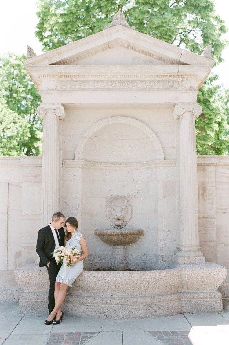 Couple sitting in front of a fountain