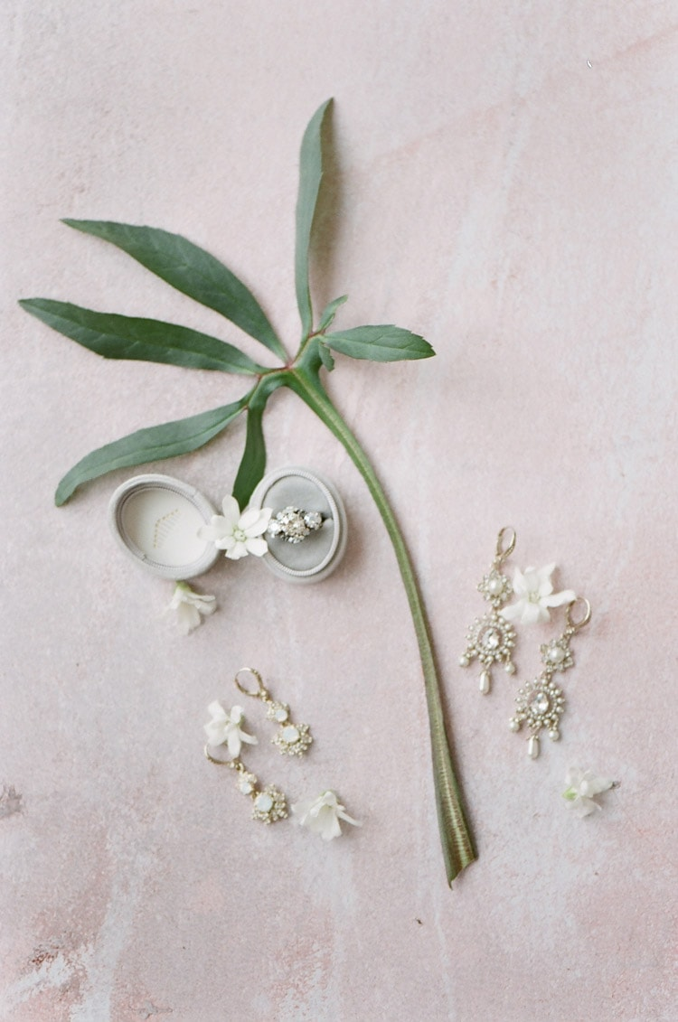 Flat lay of engagement ring and jewelry