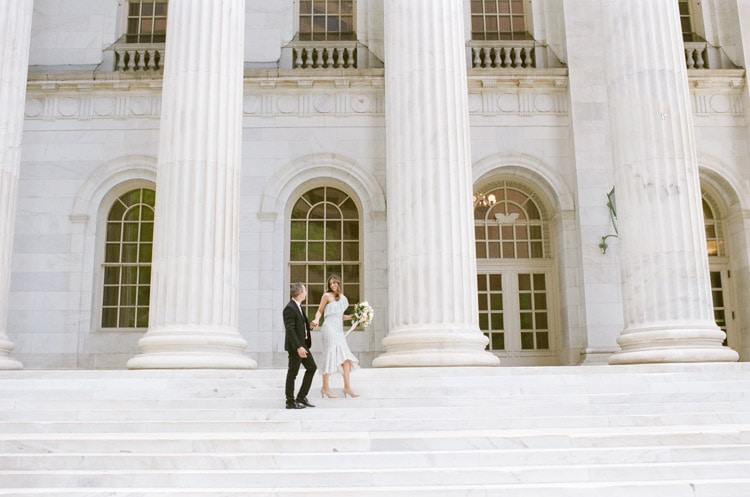Engagement portraits on the steps of the Denver courthouse