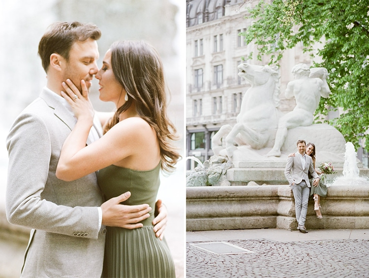 Couple kissing in front of a fountain in Munich
