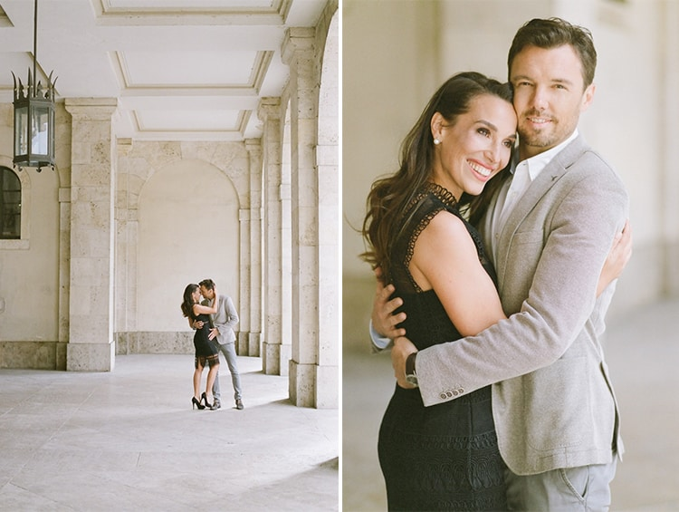 Woman in a black lace dress hugs her fiance during their engagement portraits in Munich Germany