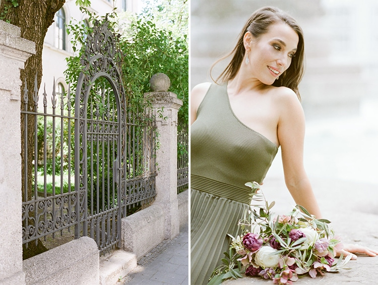 Woman in green dress holding a bouquet during her engagement portraits in Munich