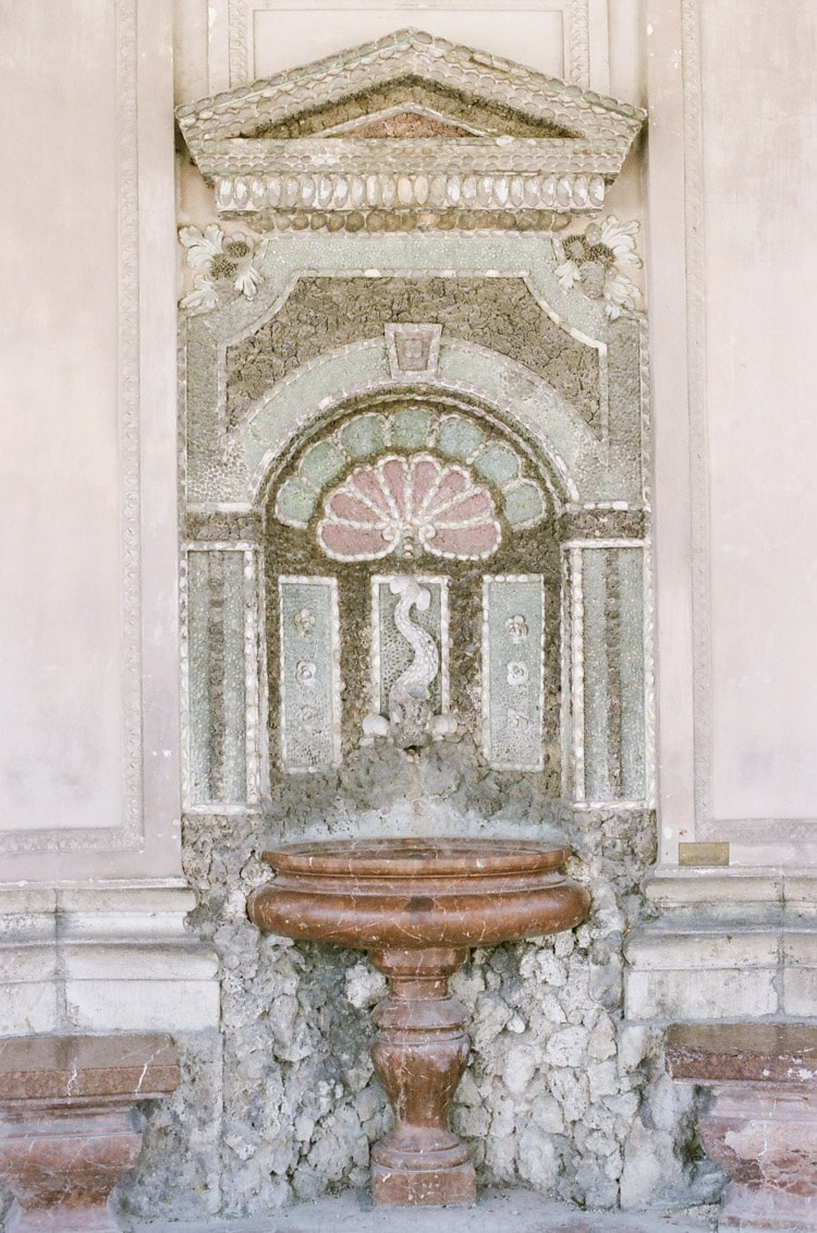Fountain in Munich featuring pink and green tile work