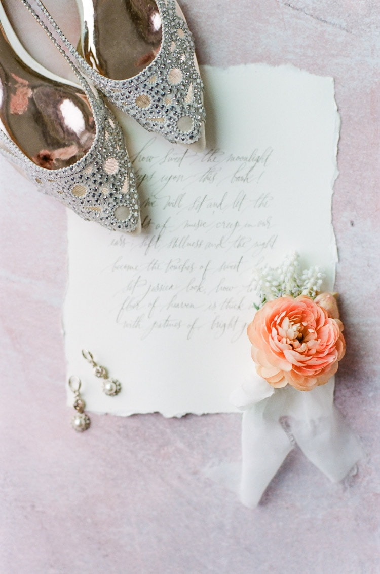 Silver shoes and a coral flower on a love note