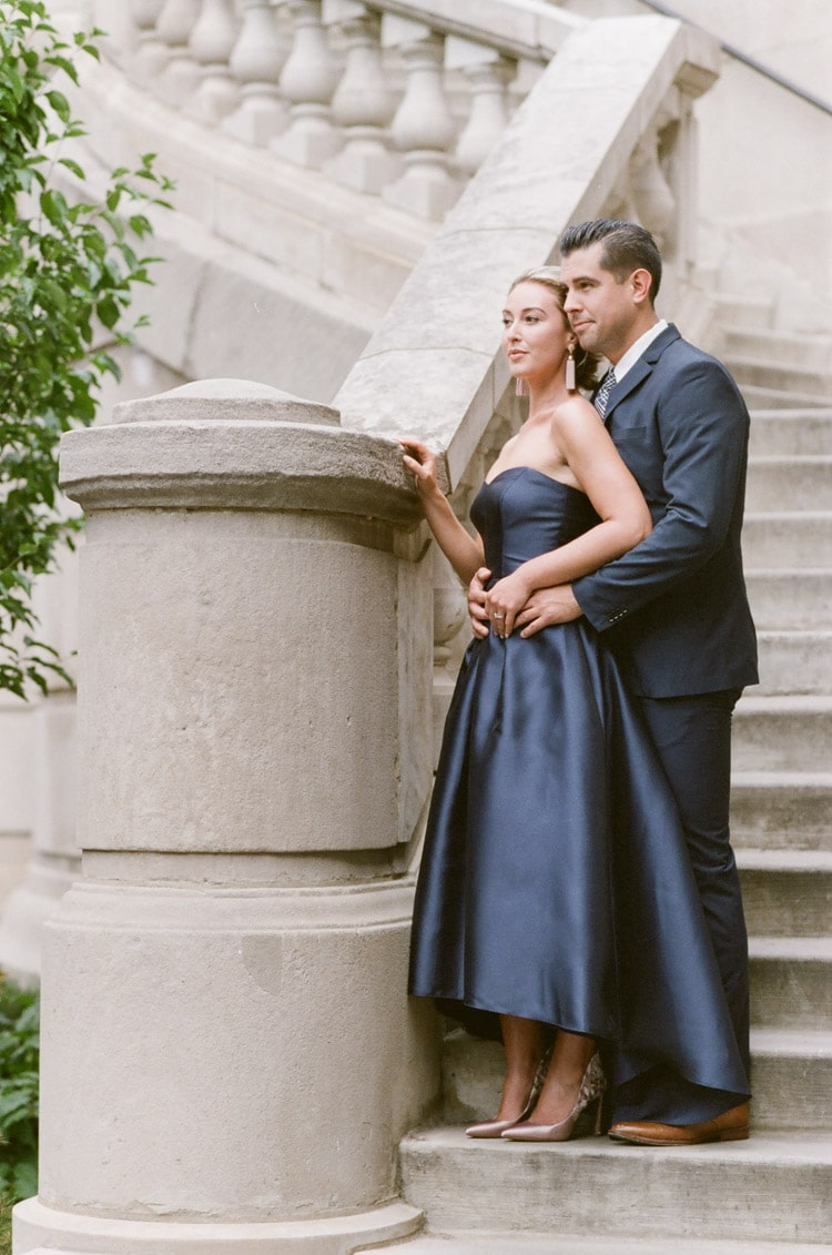 Couple standing on exterior staircase