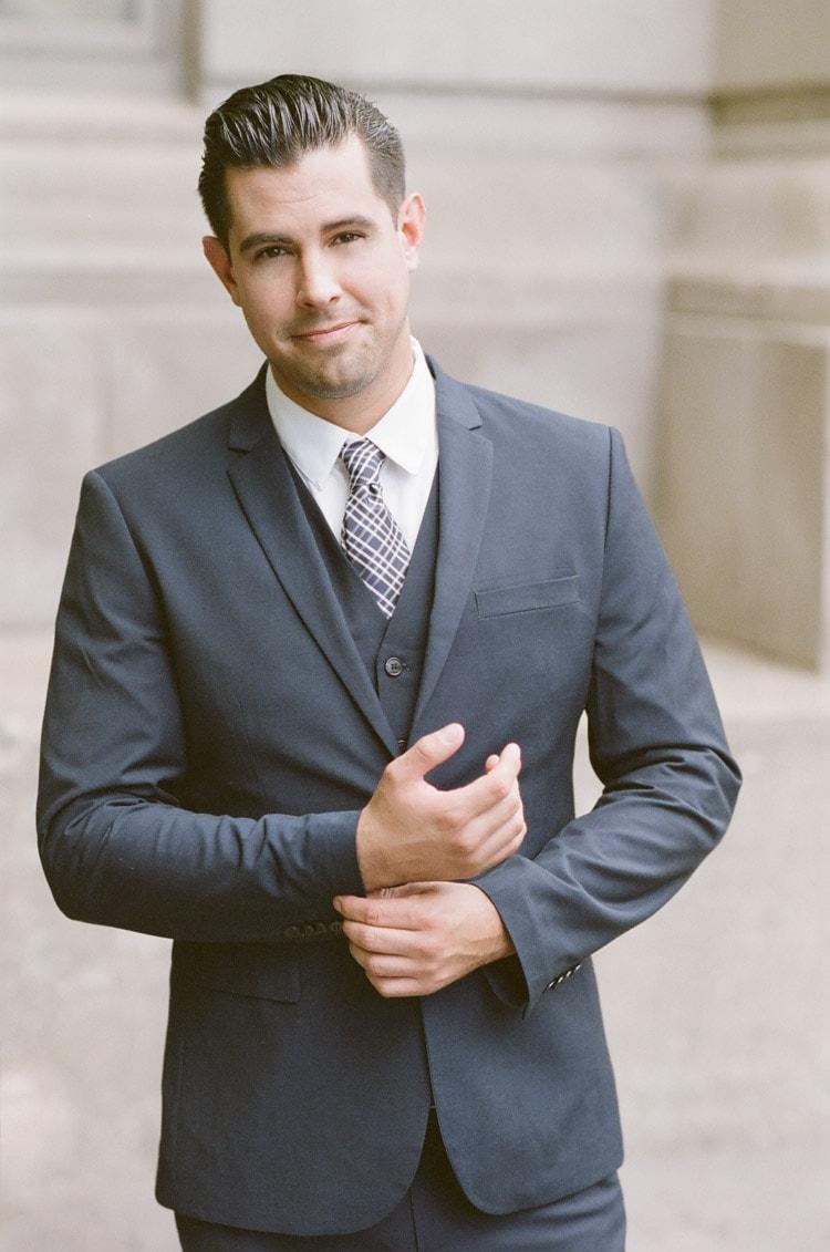 Portrait of man in navy blue suit
