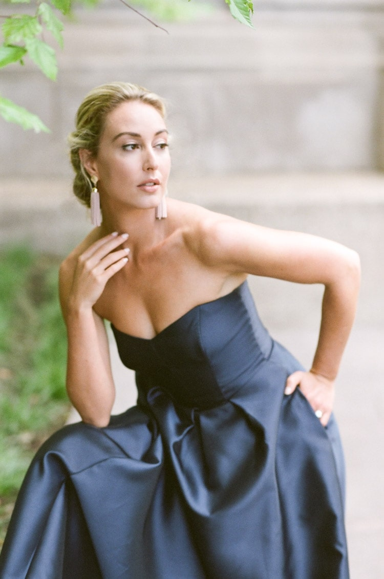 Close-up of Woman posing while wearing a strapless navy blue evening dress in Chicago