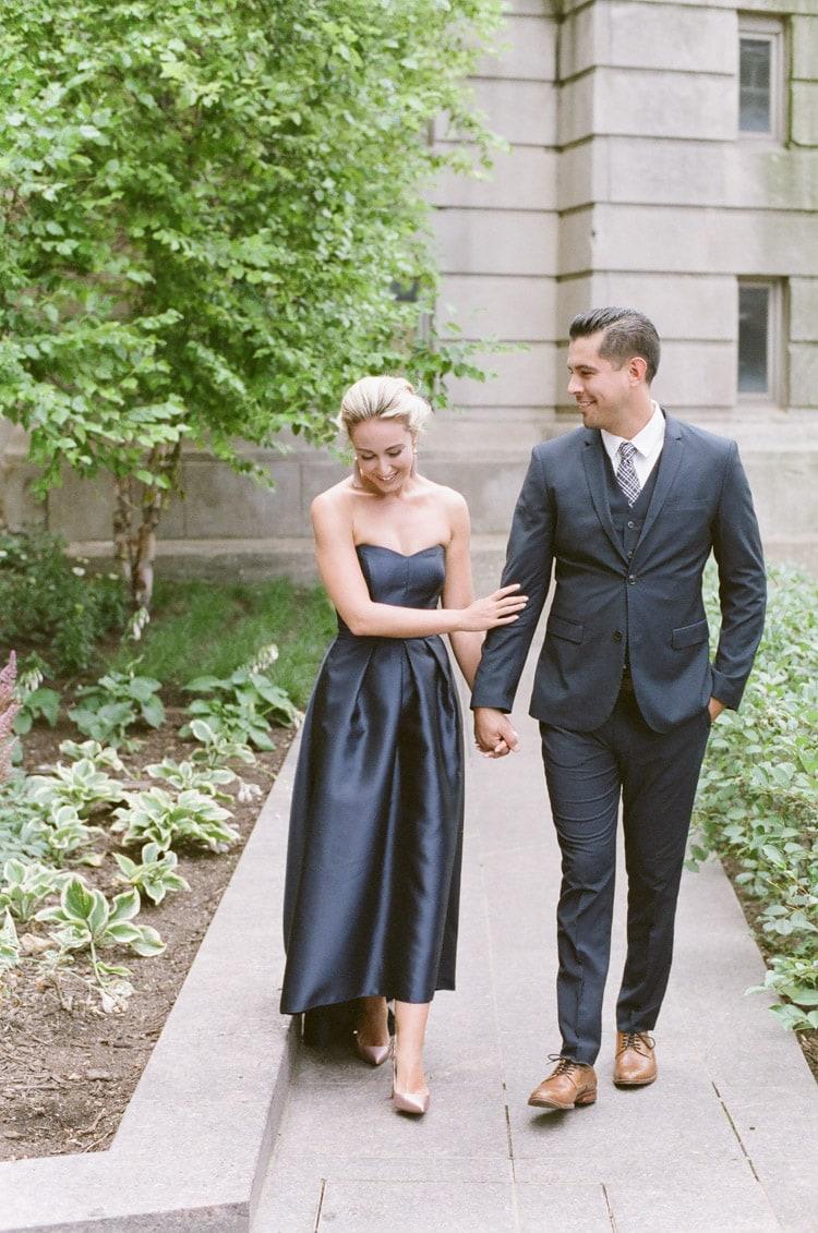 Couple walking on pathway laughing