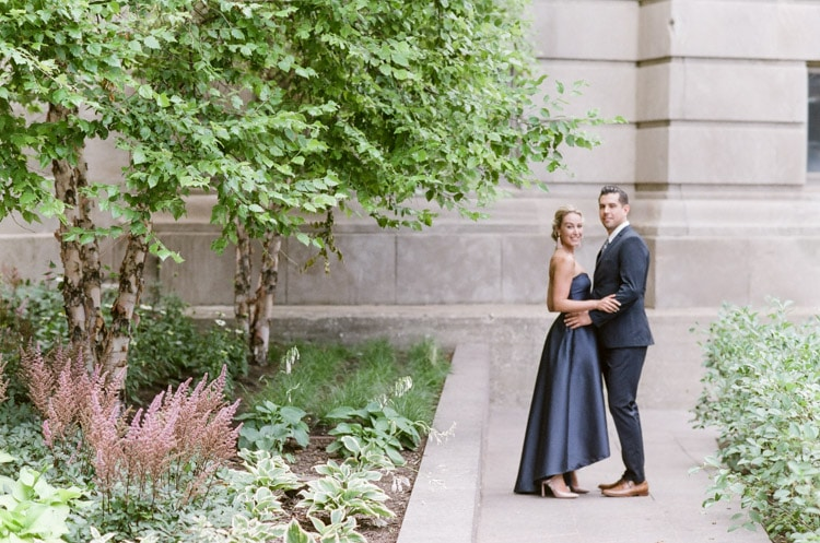Distant couple embracing and smiling with Chicago flora