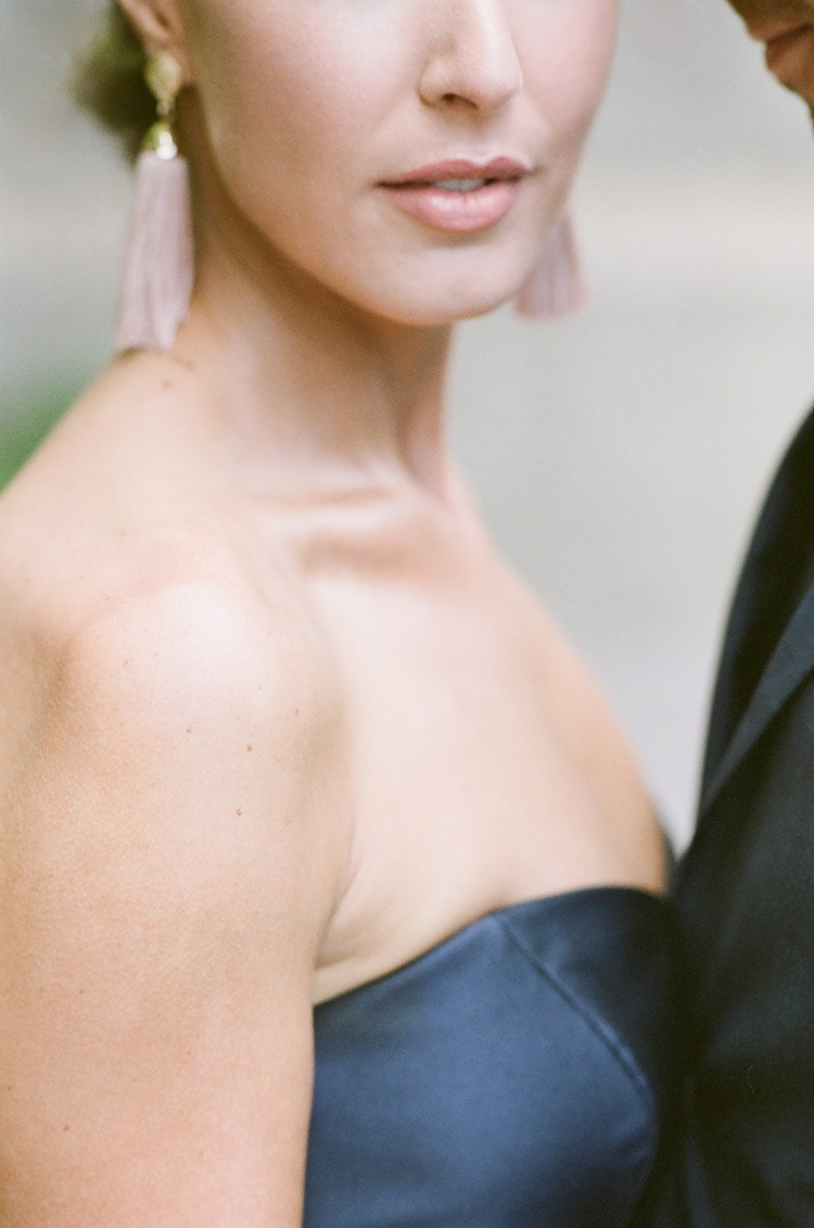 Closeup of woman's lower half of face to upper chest
