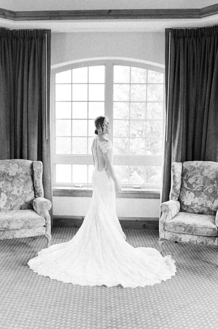 Bride posing getting ready in bridal suite