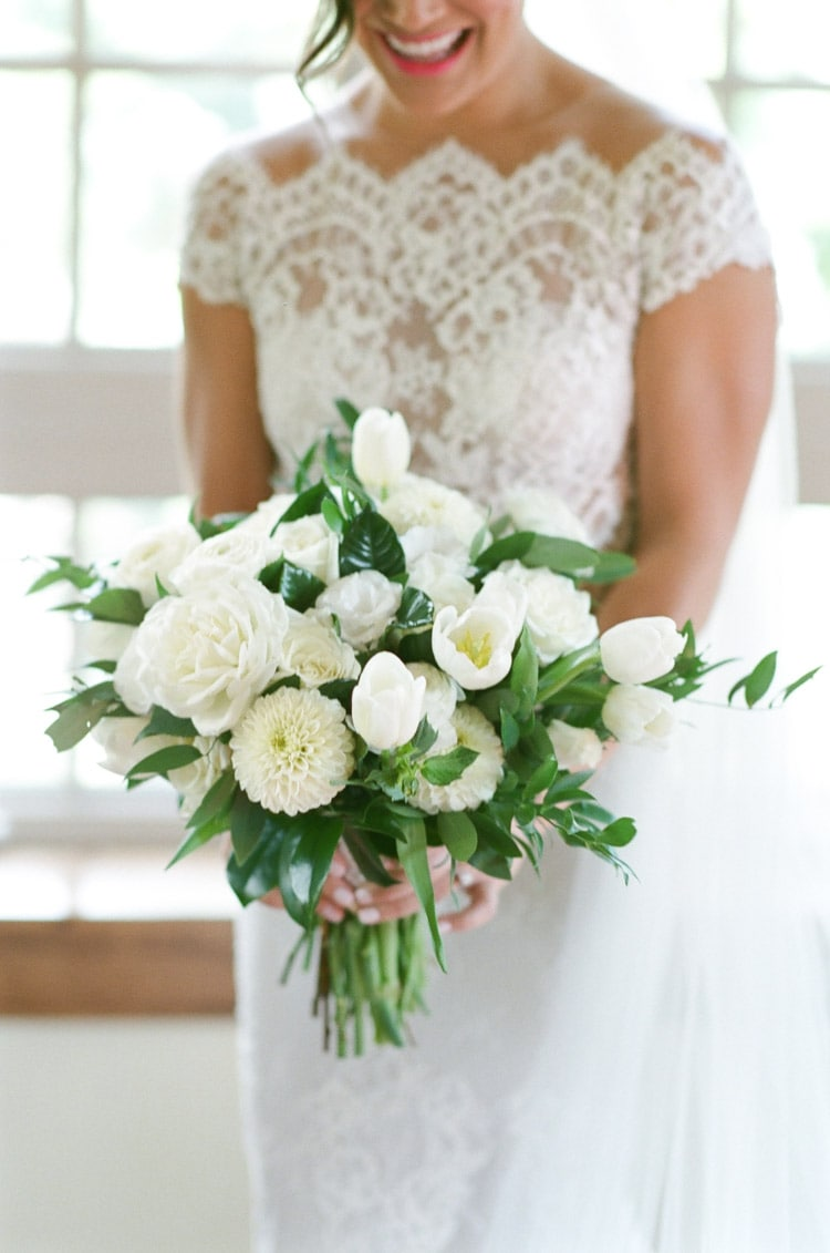 Large white bouquet being held