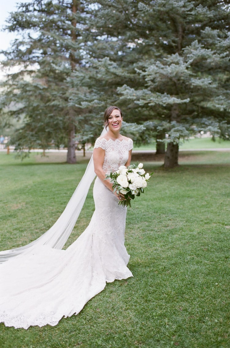 Portrait session of bride in front of pine trees