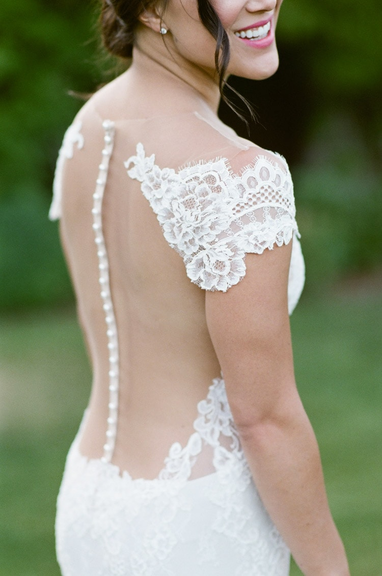 Detailed view of bride's back lace dress