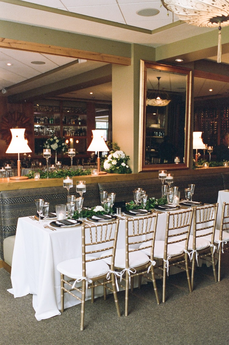 Variety of high and low arrangements accentuated with a rectangular table