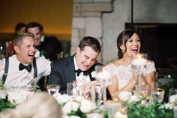 Wedding couple sitting at head table