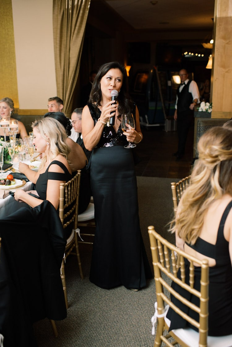 Woman giving toast at reception