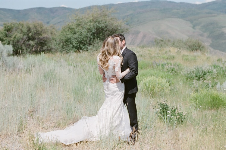 Couple embracing each other in grass fields