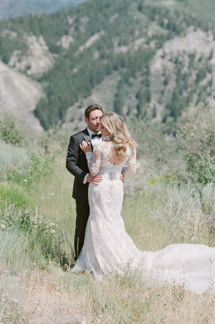 Wedding portrait of couple with mountains in the background