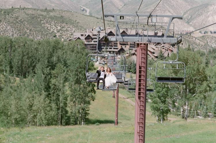 Wedding couple riding the gondola up the mountain