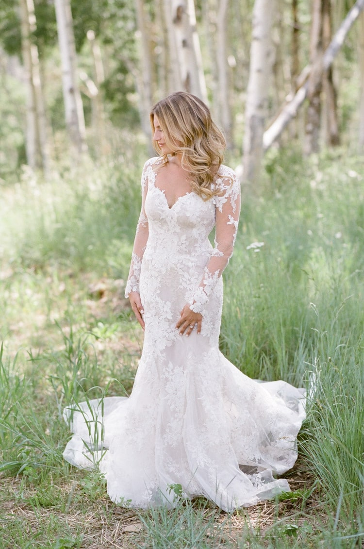Bride wearing custom lace gown by Monique Lhuillier