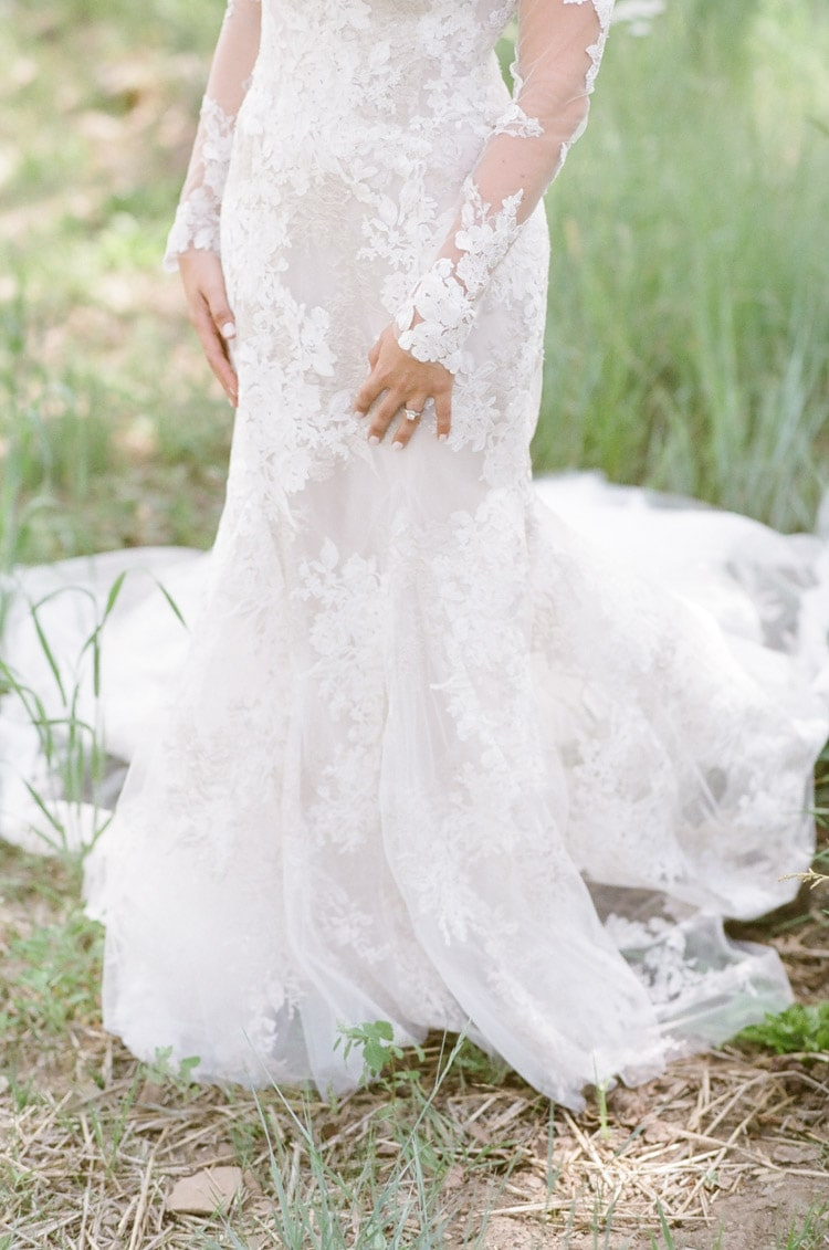 Lower half of wedding gown made of lace fabric designed by Monique Lhuillier