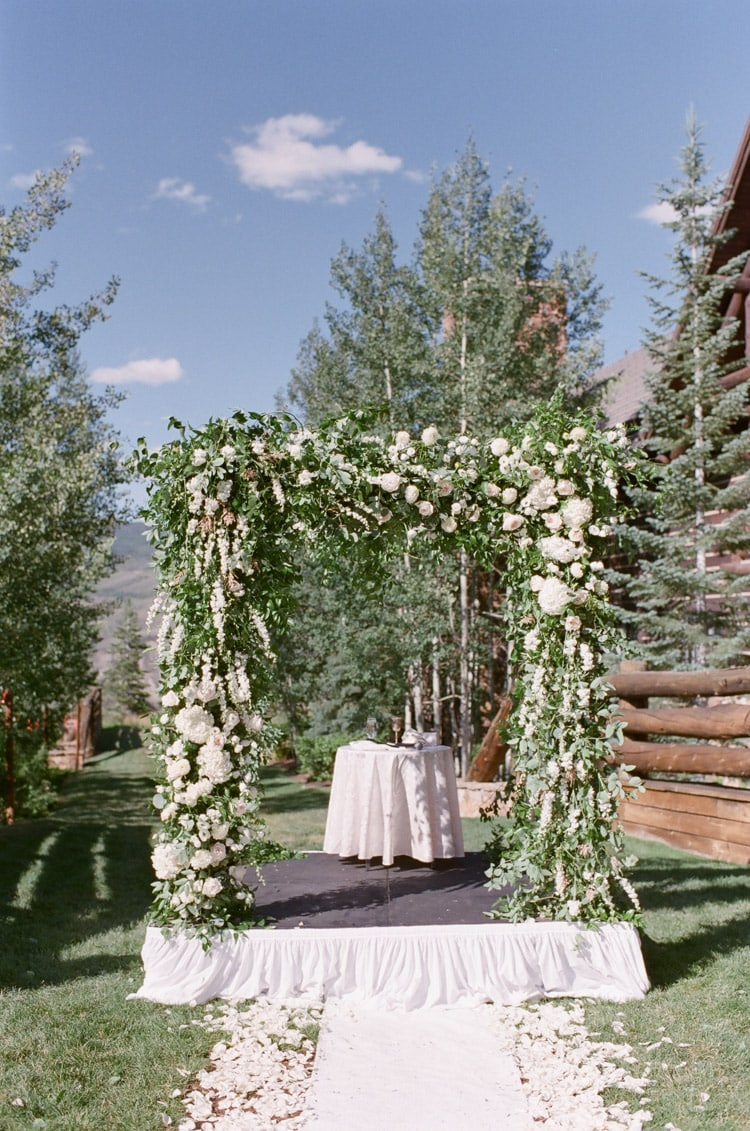 Wedding Ceremony beautiful chuppah with lots of greenery and flowers