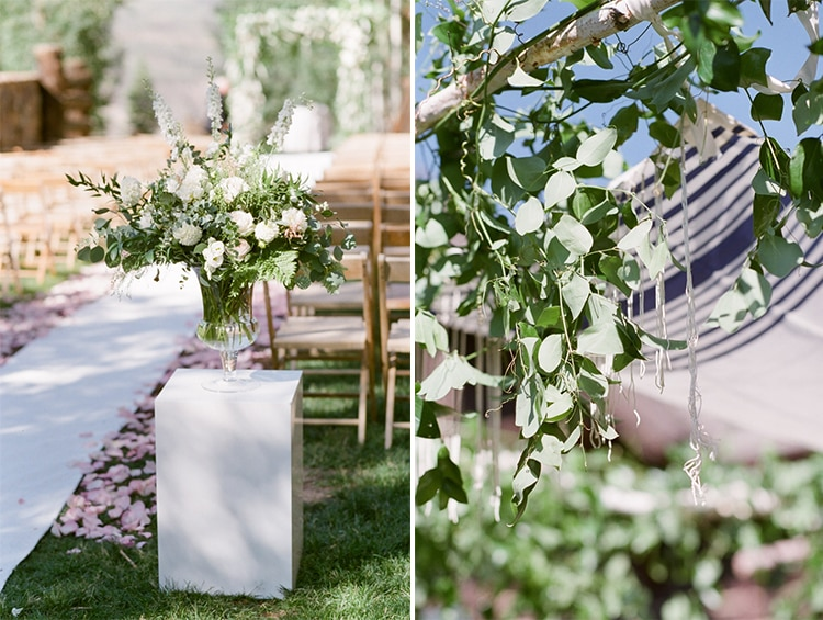 Large vase of flowers on the left and chuppah wedding canopy on the right