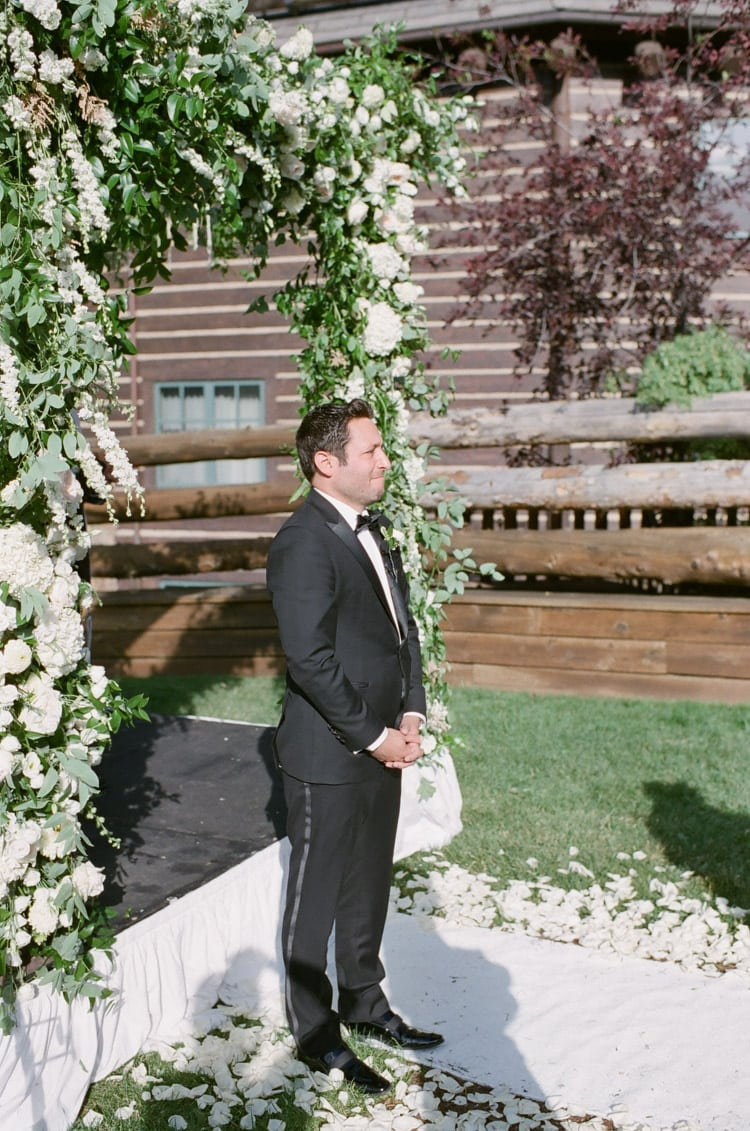 Groom waiting on his bride at beginning of ceremony