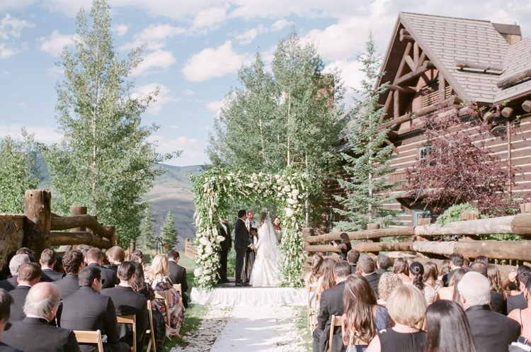 Initiation of wedding ceremony and couple under the chuppah