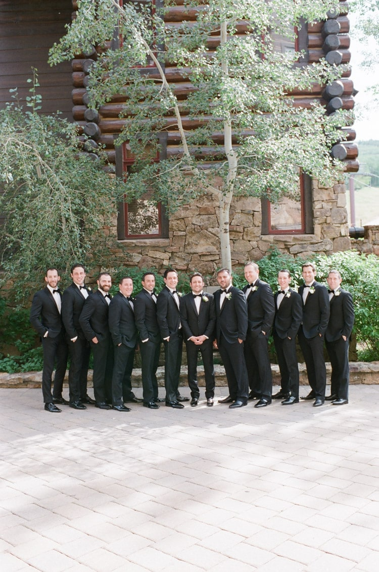 Groomsmen together in black tuxedos