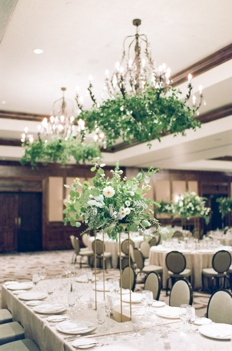 Large pieces of hanging greenery in grand ball room