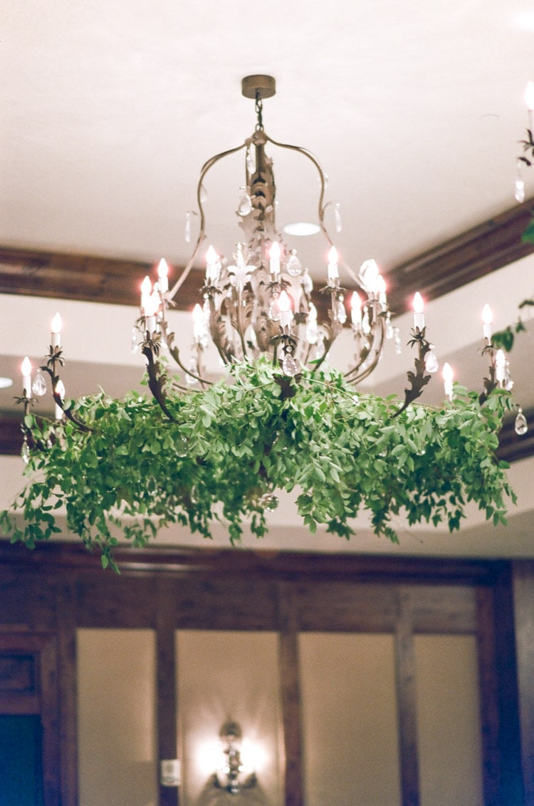 Chandelier decorated with greenery
